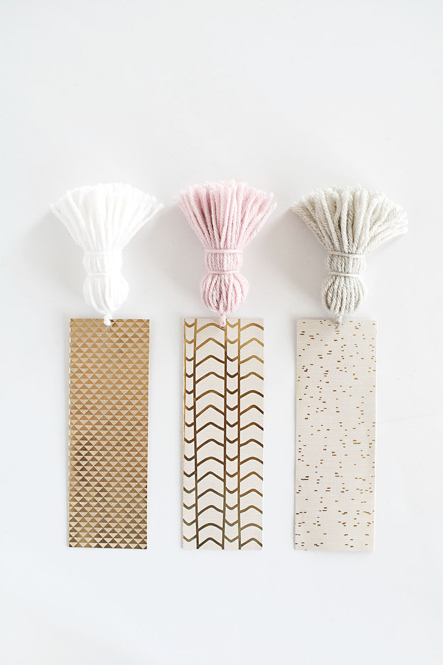 Tassel bookmarks made with decorative paper and yarn.