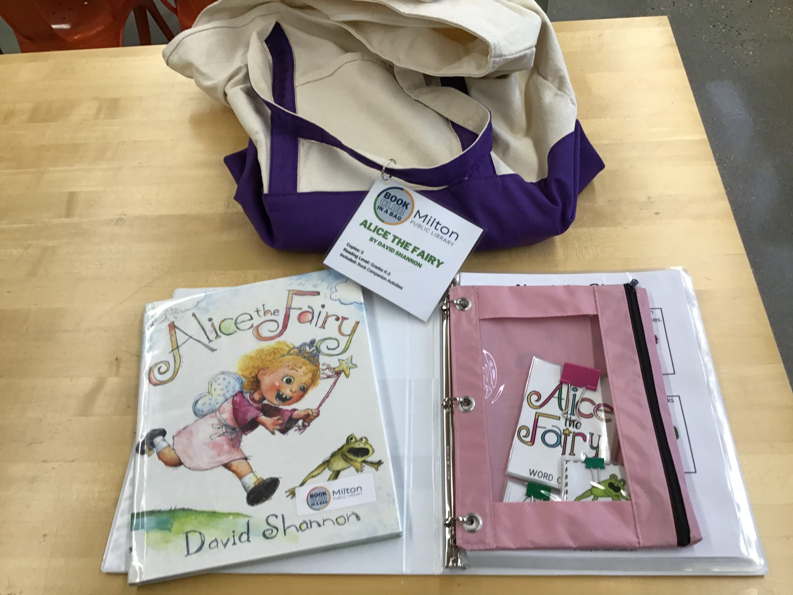 Canvas Bag with the book Alice the Fairy and the book club guide next to it