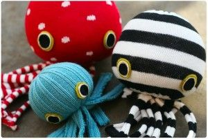 A red, blue, and black and white octopus made out of socks