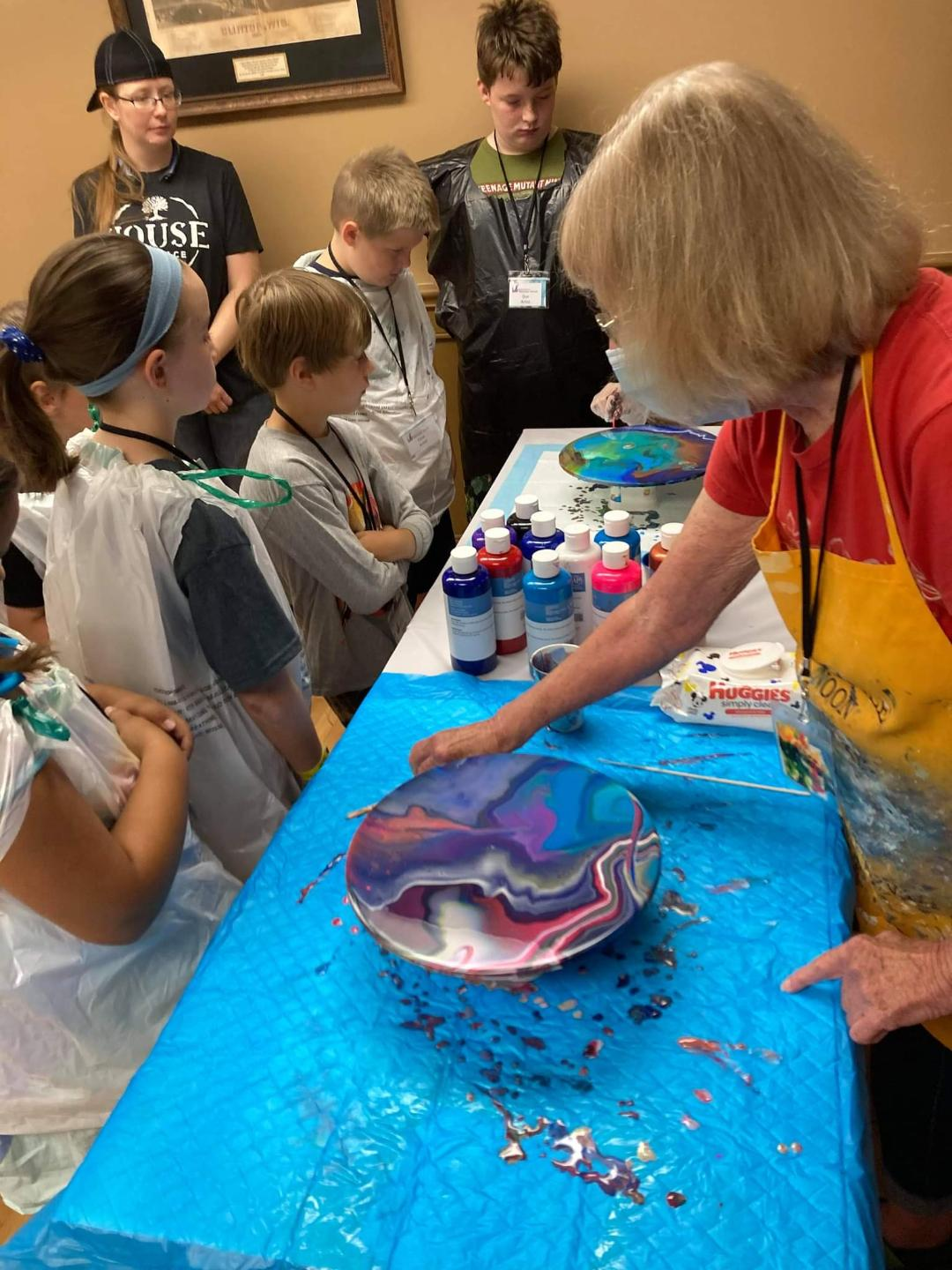Nancy McKinnon demonstrated how to pour acrylic paint.